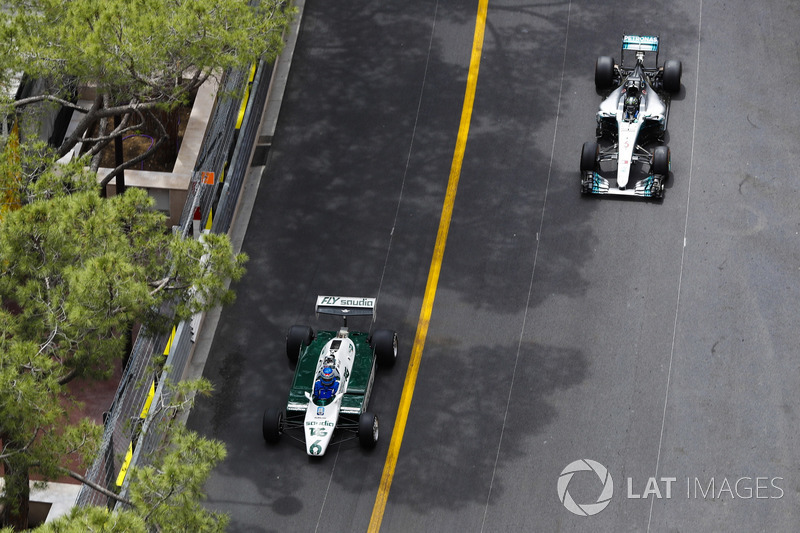 Keke Rosberg leads his son Nico Rosberg as they tour the circuit in their world title winning cars