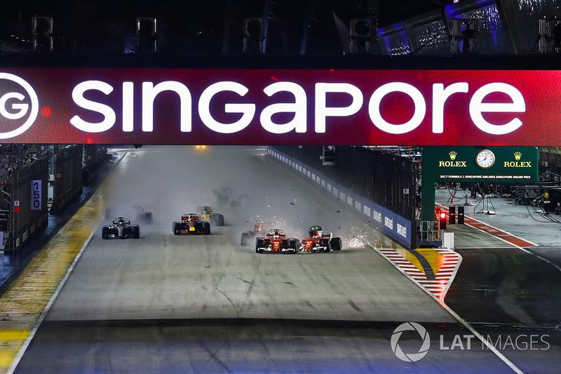 Sebastian Vettel, Ferrari SF70H, Max Verstappen, Red Bull Racing RB13, Kimi Raikkonen, Ferrari SF70H, collide at the start