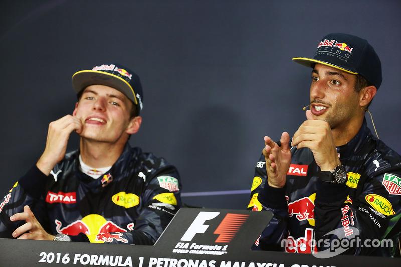 Race winner Daniel Ricciardo, Red Bull Racing (Right) in the FIA Press Conference with team mate Max