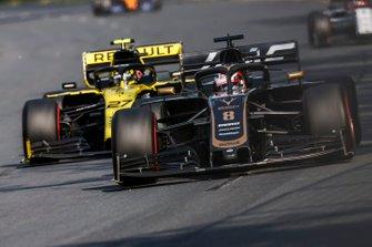 Romain Grosjean, Haas F1 Team VF-19, leads Nico Hulkenberg, Renault R.S. 19