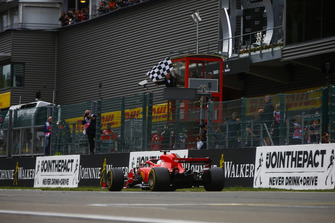 Sebastian Vettel, Ferrari SF71H, takes the chequered flag at the finish