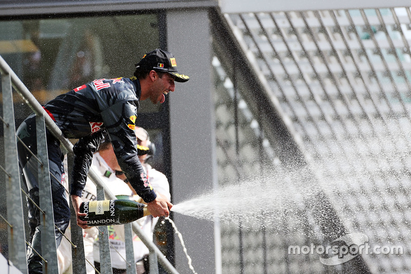 Daniel Ricciardo, Red Bull Racing celebrates his second position with the champagne on the podium