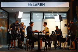 Jenson Button, McLaren getting interviewed by Mark Webber