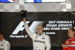 Valtteri Bottas, Mercedes AMG F1, on the podium after winning the Grand Prix