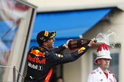 Daniel Ricciardo, Red Bull Racing, sprays champagne on the podium