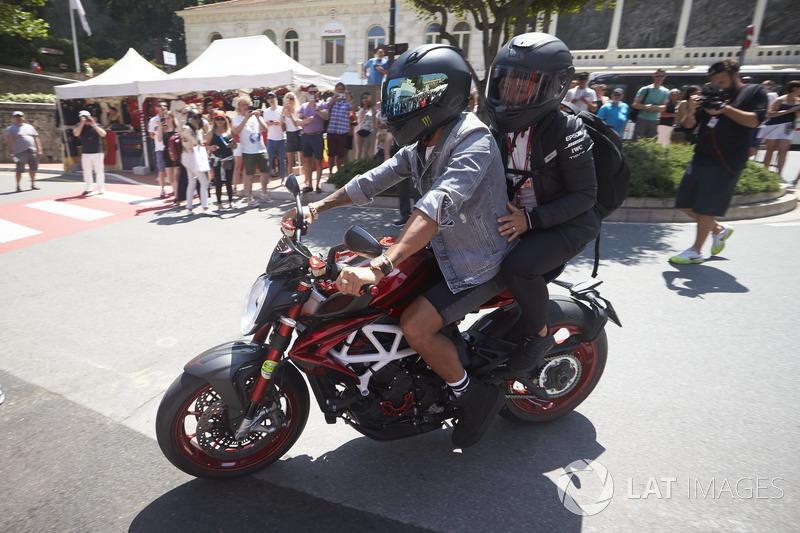 Lewis Hamilton, Mercedes AMG F1, rides his motorcycle