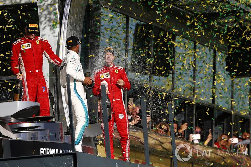 Kimi Raikkonen, Ferrari, 3rd position, Lewis Hamilton, Mercedes AMG F1, 2nd position, and Sebastian