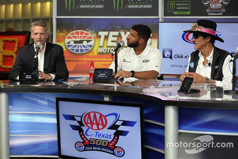 NASCAR Chief Operating Officer Steve Phelps, NASCAR driver Darrell Wallace Jr., and team owner Richard Petty