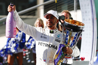 Lewis Hamilton, Mercedes AMG F1, celebrates with his champagne and trophy on the podium