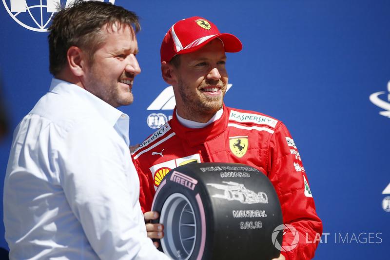 Paul Hembrey, Director, Pirelli Motorsport, presents Sebastian Vettel, Ferrari, with the Pirelli Pol