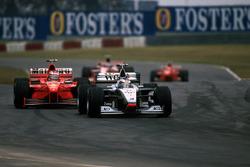 Mika Hakkinen, McLaren Mercedes MP4/13 leads Michael Schumacher, Ferrari F300