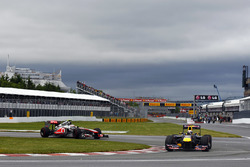 Sebastian Vettel, Red Bull Racing RB7 leads Jenson Button, McLaren MP4-26