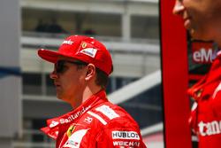 Kimi Raikkonen, Ferrari, heads back to the garage on foot after retiring