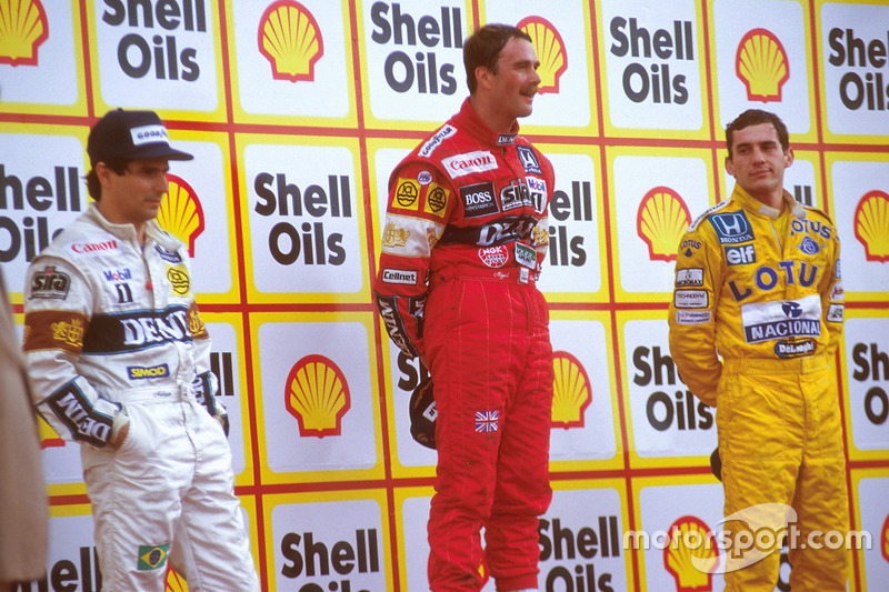 Podium: race winner Nigel Mansell, Williams, second place Nelson Piquet, Williams, third place Ayrto