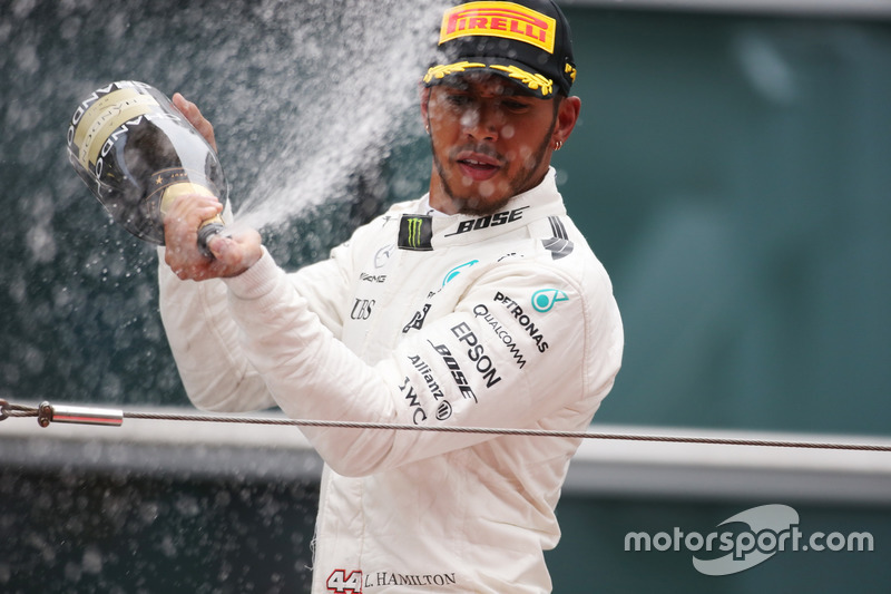 Lewis Hamilton, Mercedes AMG, sprays the victory Champagne
