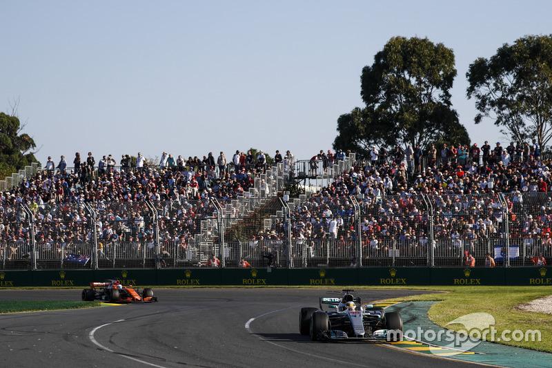 Lewis Hamilton, Mercedes AMG F1 W08, leads Fernando Alonso, McLaren MCL32