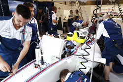 Mechanics are working on the car of Felipe Massa, Williams FW40