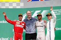 The podium (L to R): Sebastian Vettel, Ferrari, second; Lewis Hamilton, Mercedes AMG F1, race winner; Valtteri Bottas, Williams, third