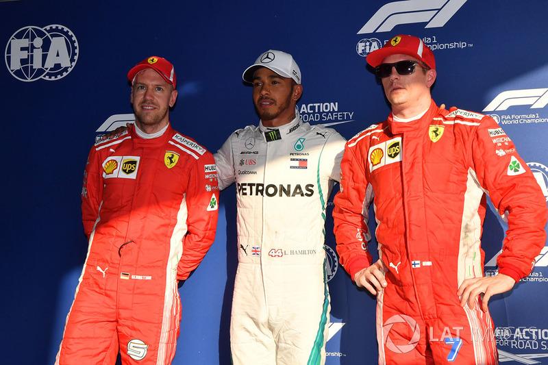 Sebastian Vettel, Ferrari, pole sitter Lewis Hamilton, Mercedes-AMG F1 and Kimi Raikkonen, Ferrari in parc ferme