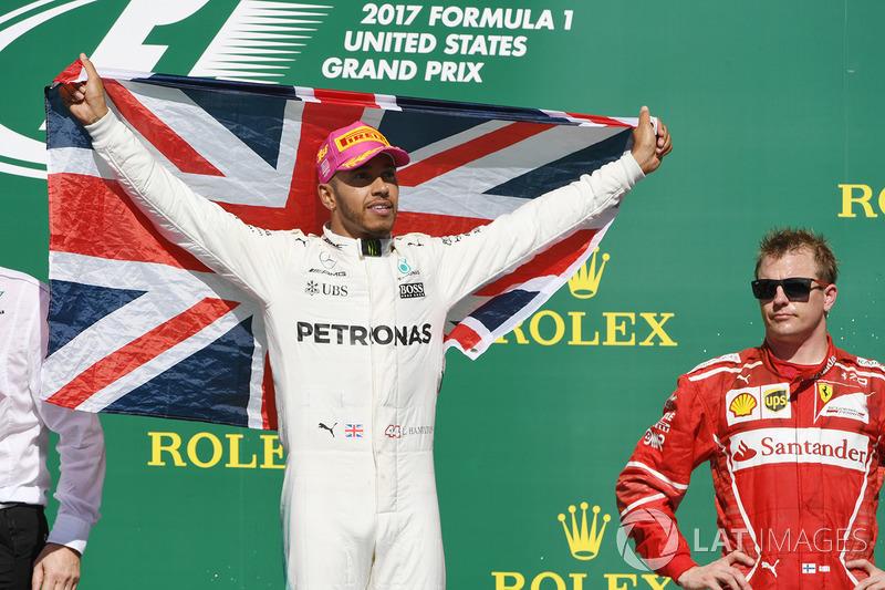 Race winner Lewis Hamilton, Mercedes AMG F1 celebrates on the podium with the union flag and Kimi Raikkonen, Ferrari