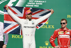 Race winner Lewis Hamilton, Mercedes AMG F1 celebrates on the podium with the union flag and Kimi Raikkonen, Ferrari