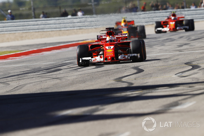 Sebastian Vettel, Ferrari SF70H, crosses the line ahead of Max Verstappen, Red Bull Racing RB13, Kim