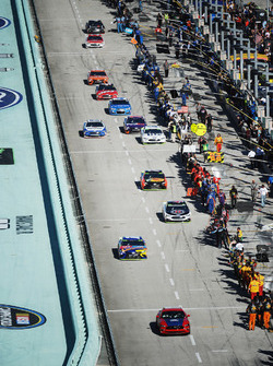 The cars leave pit road