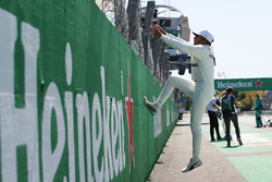 Race winner Lewis Hamilton, Mercedes AMG F1, climbs the pit wall