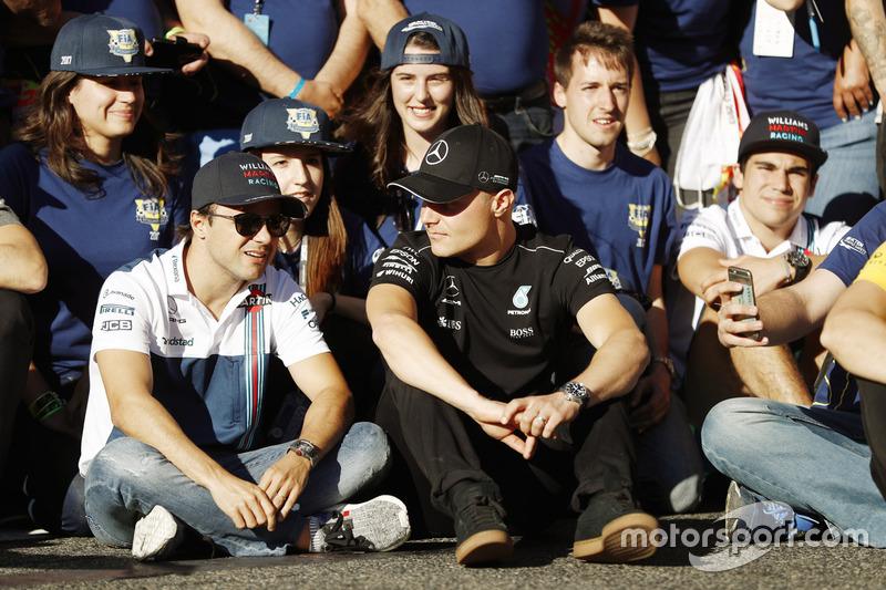 Felipe Massa, Williams, talks to Valtteri Bottas, Mercedes AMG F1, at the FIA Volunteers Day celebra