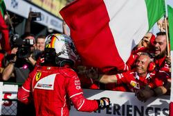 Sebastian Vettel, Ferrari, 1st Position, celebrates in Parc Ferme with his team