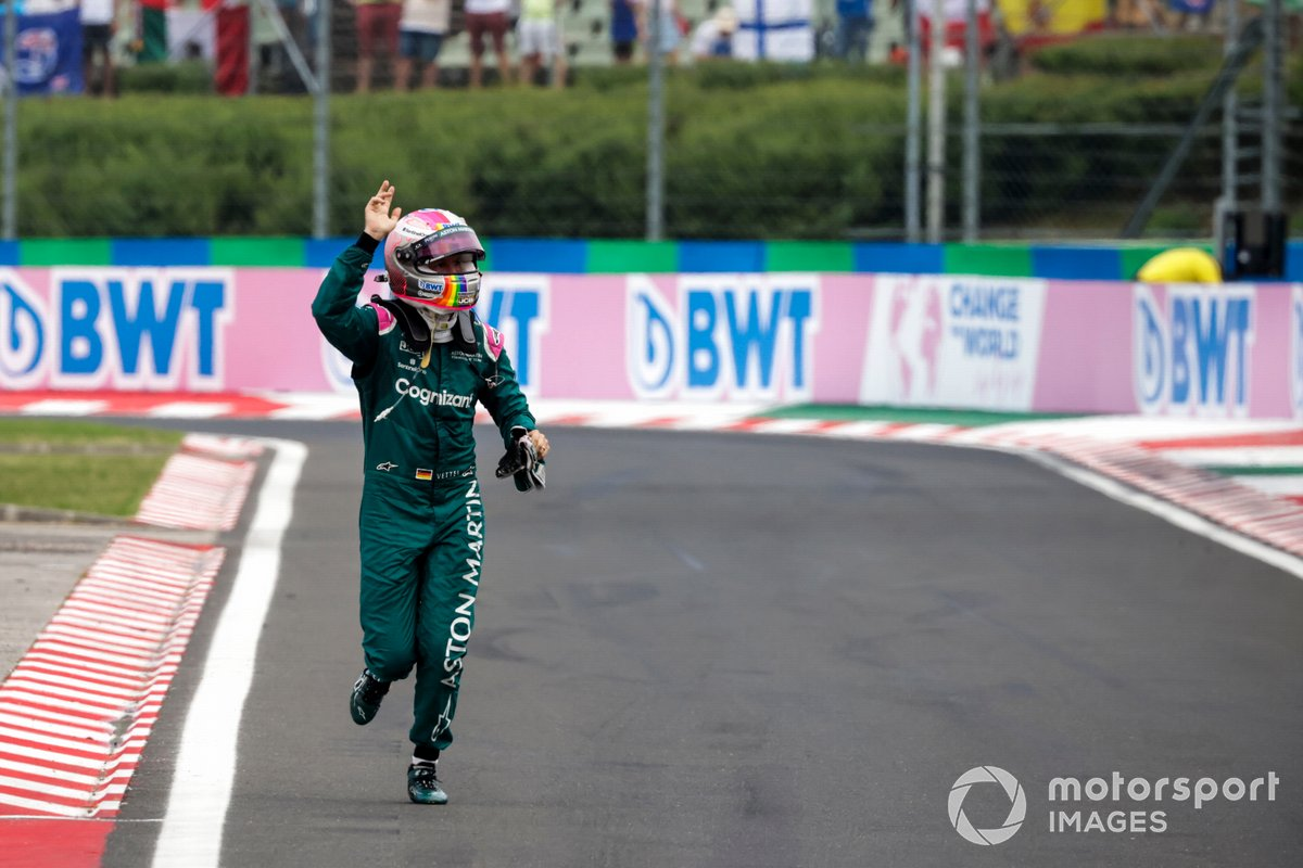 Stopping his car on the inlap meant Vettel had to return on foot - catching the attention of FIA policeman Bauer