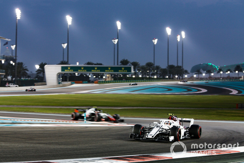 Charles Leclerc, Sauber C37 leads Kevin Magnussen, Haas F1 Team VF-18