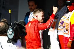 Race winner Sebastian Vettel, Ferrari, heads up to the podium