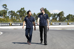 Toro Rosso Honda personnel walk the track