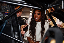 Former Destiny's Child singer Kelly Rowland chats with Simona de Silvestro, Nissan Motorsports