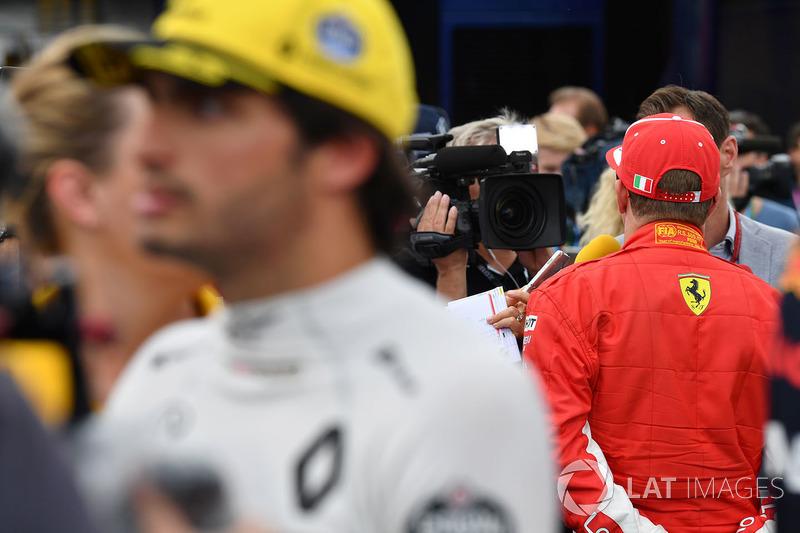 Kimi Raikkonen, Ferrari talks with the media