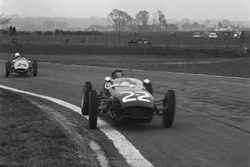 1960 Formula Junior Championship. Goodwood, West Sussex, England. 19th March 1960. Jim Clark, Lotus 18-Ford, 1st position, leads John Surtees, Cooper T52-BMC, 2nd position. This was Surtees first ever car race since retiring from Motorcycle racing and Clark's first win in single seaters