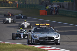 The Safety Car leads Valtteri Bottas, Mercedes AMG F1 W09, and the rest of the field