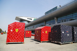 Ferrari and Red Bull cargo containers