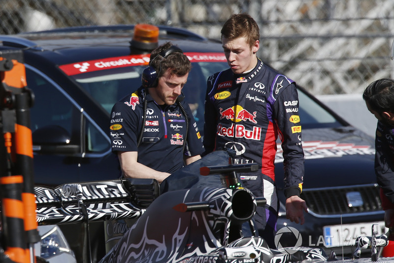 Daniil Kvyat, Red Bull Racing RB11, talks to a Red Bull team member after stopping on track