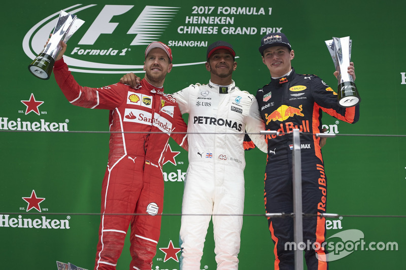 Podium: second place Sebastian Vettel, Ferrari, Aldo Costa, Engineering Director, Mercedes AMG, Race winner Lewis Hamilton, Mercedes AMG, third place Max Verstappen, Red Bull Racing on the podium