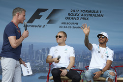 Valtteri Bottas, Mercedes AMG, and Lewis Hamilton, Mercedes AMG, are interviewed on stage by David Coulthard, Channel 4 F1