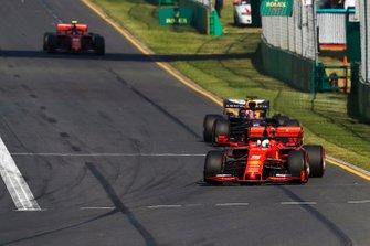 Sebastian Vettel, Ferrari SF90, leads Max Verstappen, Red Bull Racing RB15, and Charles Leclerc, Ferrari SF90