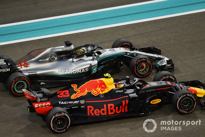 Lewis Hamilton, Mercedes-AMG F1 W09 with glowing brake discs battle with Max Verstappen, Red Bull Racing RB14