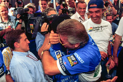 Race winner Micheal Schumacher, Benetton, celebrates with his manager Willi Weber and Flavio Briatore
