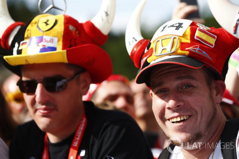 A Fernando Alonso, McLaren, supporter wears a novelty