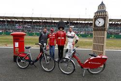 Stoffel Vandoorne, McLaren, MarcGene of Ferrari and Jenson Button, McLaren, with a dummy Scots Guard and bicycles