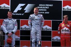 Podium: second place David Coulthard, McLaren, Race winner Mika Hakkinen, McLaren, third place Rubens Barrichello, Ferrari