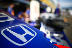 A Honda logo on the nose of a Toro Rosso in the pit lane