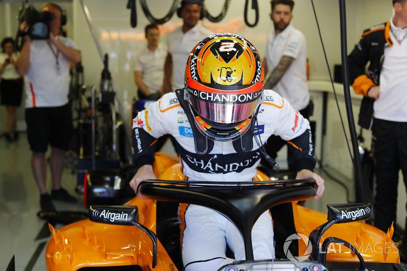 Stoffel Vandoorne, McLaren, enters his cockpit.